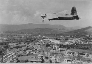 firenze A Martin B-26 Marauder of the 12th AF flies low over railyards in Florence to inspect the results of attacks by its sister ships
