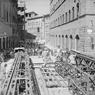 People of Florence watching the Royal Engineers at work erecting a Bailey Bridge over the river Arno