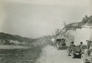 Long lines of infantry of the 351st Infantry Regiment, 88th Division drive along Highway 64 towards Bologna at Marzabotto