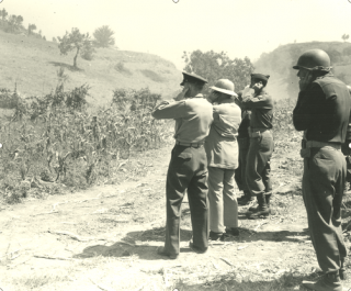 Demonstration of artillery weapon in Colle Mezzano Livorno Italy on 6 July 1944
