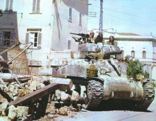 us sherman tank in the streets of pisa italy  summer 1944