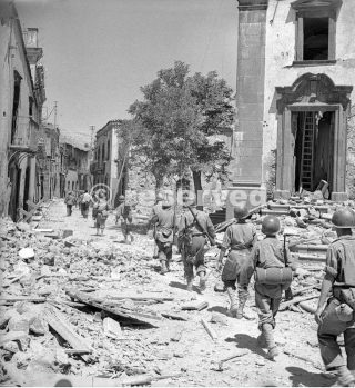 17 August 1943 American troops advance through a damaged street in Randazzo sicily_sicilia word war