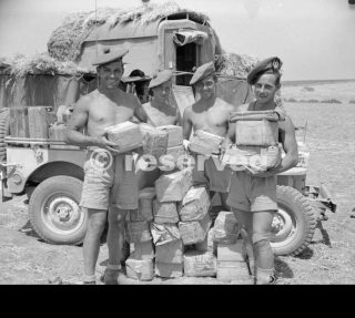 sicilia area Men of 51st Highland Division show off their stock of cigarettes 24 July 1943