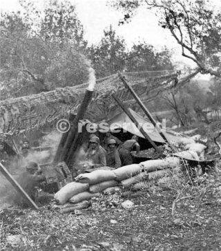 FIRING A HOWITZER ON THE VENAFRO FRONT with camouflage net pulled back for firing._wwii