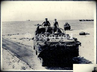 a-british-dukw-amphibious-vehicle-moving-up-the-beach-at-salerno-italy-september-1943_ww2-