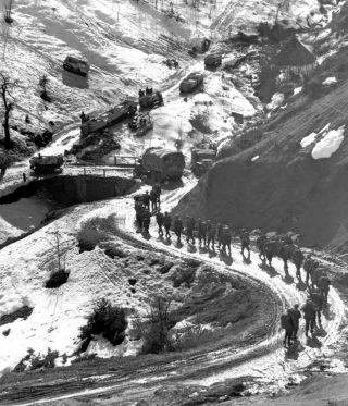 INFANTRY COLUMN passing of Highway 65 February 1945