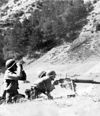 MACHINE GUNNERS FIRING AT GERMANS in the Monticelli area near Giogo Pass