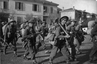 Soldiers of the Maori Battalion moving into line in the Faenza sector Italy