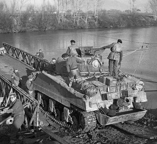 Sherman tank drives onto a raft which will transport it across the Garigliano Rive