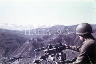 Klemme inspects a captured German machine gun MG 42 Castel d'Aiano Area Italy1945