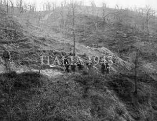 Mt Pigna Area Italy A group of German prisoners being used to bring out dead American soldiers The Americans are with the 10th Mt Div