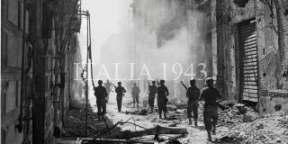 reconnaissance unit searches for enemy snipers in Messina Sicily Italy August 1943